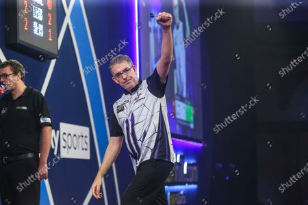 Jeff Smith celebrates beating Keane Barry in the first round during the William Hill World Darts Championship at Alexandra Palace, London