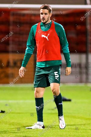 Plymouth Argyle defender Scott Wootton (5) in the pre match warm up during the EFL Sky Bet League 1 match between Crewe Alexandra and Plymouth Argyle at Alexandra Stadium, Crewe