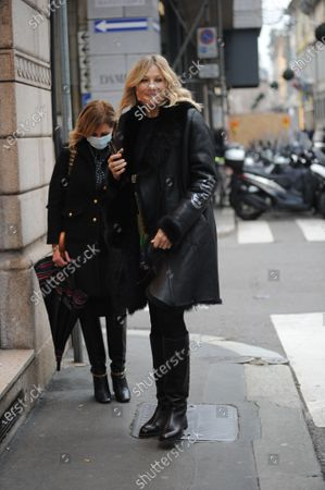 Stock Photo of Natasha Stefanenko takes a walk with a friend before leaving in a taxi.