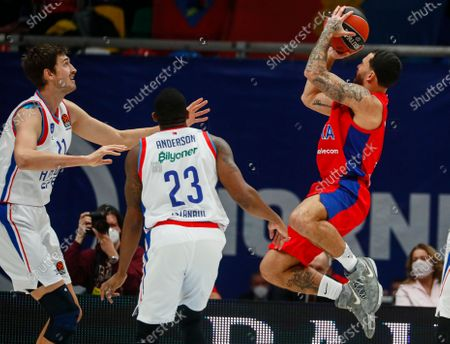 Stock Photo of Mike James (R) of CSKA Moscow in action against Tibor Pleiss (L) and James Anderson (C) of Anadolu Efes Istanbul during the Euroleague basketball match between CSKA Moscow and Anadolu Efes Istanbul in Moscow, Russia, 15 December 2020.
