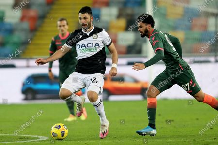 Udinese's Tolgay Arslan (L) and Crotone's Emmanuel Riviere in action during the Italian Serie A soccer match Udinese Calcio vs FC Crotone at the Friuli - Dacia Arena stadium in Udine, Italy, 15 December 2020.