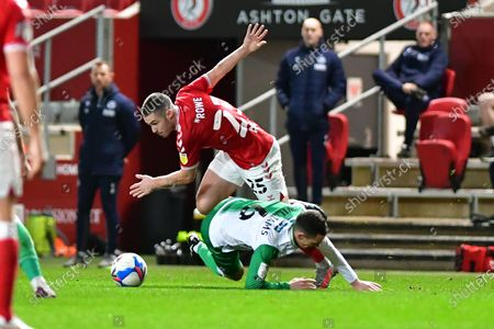 Bristol City midfielder Tommy Rowe (25) and Millwall midfielder Shaun Williams (6)  battles for possession during the EFL Sky Bet Championship match between Bristol City and Millwall at Ashton Gate, Bristol