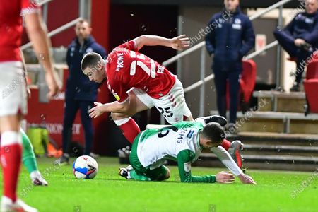 Stock Image of Bristol City midfielder Tommy Rowe (25) and Millwall midfielder Shaun Williams (6)  battles for possession  during the EFL Sky Bet Championship match between Bristol City and Millwall at Ashton Gate, Bristol