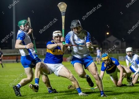 Waterford vs Tipperary. Waterford's Sam Fitzgerald and Iarlaith Daly with Seán Ryan of Tipperary