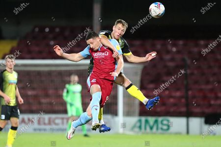 Ryan Loft, Scott Wilson during the EFL Sky Bet League 2 match between Scunthorpe United and Barrow at the Sands Venue Stadium, Scunthorpe