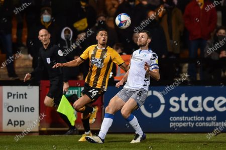 Colchester United's Thomas Smith (5) and Harvey Knibbs (26) of Cambridge United battle for possession during the EFL Sky Bet League 2 match between Cambridge United and Colchester United at the Cambs Glass Stadium, Cambridge