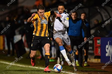 Stock Photo of Paul Digby (4) of Cambridge United and Colchester United's Cohen Bramall (3) battle for possession during the EFL Sky Bet League 2 match between Cambridge United and Colchester United at the Cambs Glass Stadium, Cambridge
