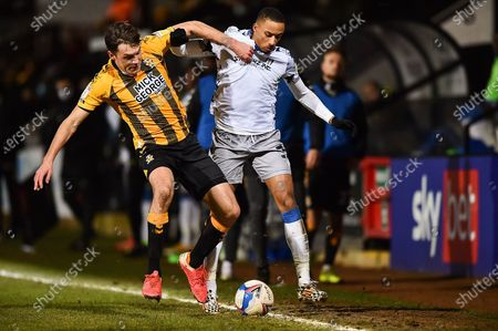 Paul Digby (4) of Cambridge United and Colchester United's Cohen Bramall (3) battle for possession during the EFL Sky Bet League 2 match between Cambridge United and Colchester United at the Cambs Glass Stadium, Cambridge