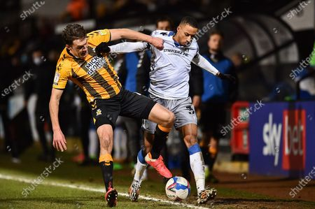 Stock Picture of Paul Digby (4) of Cambridge United and Colchester United's Cohen Bramall (3) battle for possession during the EFL Sky Bet League 2 match between Cambridge United and Colchester United at the Cambs Glass Stadium, Cambridge