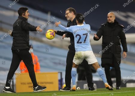 Joao Cancelo of Manchester City (C) and West Bromwich's manager Slaven Bilic react during the English Premier League match between Manchester City vs West Bromwich Albion FC in Manchester, Britain, 15 December 2020.