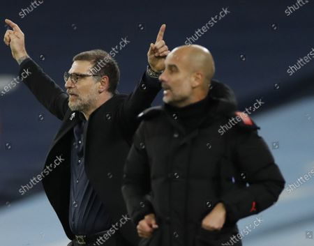 West Bromwich's manager Slaven Bilic (L) gives instructions to his players as Manchester City's manager Pep Guardiola (R) follows the game during the English Premier League match between Manchester City vs West Bromwich Albion FC in Manchester, Britain, 15 December 2020.