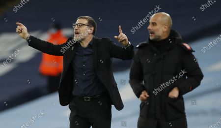 West Bromwich's manager Slaven Bilic (L) gives instructions to his players as Manchester City's manager Pep Guardiola follows the game during the English Premier League match between Manchester City vs West Bromwich Albion FC in Manchester, Britain, 15 December 2020.