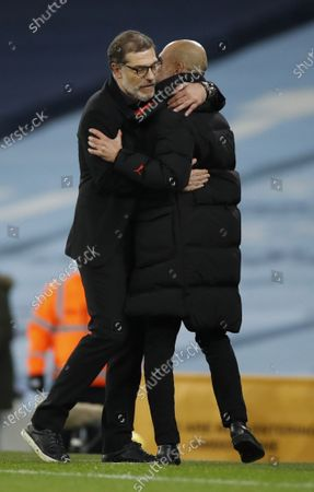 Stock Photo of West Bromwich's manager Slaven Bilic (L) greets Manchester City's manager Pep Guardiola (R) at the end of the English Premier League match between Manchester City and West Bromwich Albion FC in Manchester, Britain, 15 December 2020.