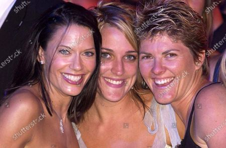 L-R: TV Personality Naomi Robson (AUS), media girl Jo Stanley (AUS) and Beach Volleyball Gold Medalist Natalie Cook (AUS). Red Bull Racing Welcome Party, Formula One World Championship, Rd1, Australian Grand Prix, Preparations, Albert Park, Melbourne, Australia, 3 March 2005. DIGITAL IMAGE