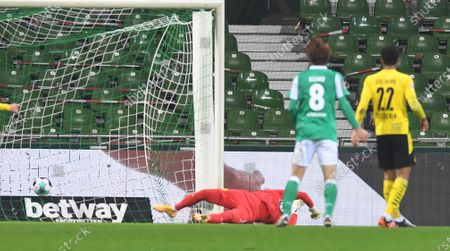 Dortmund goalkeeper Roman Buerki fails to save a Bremen goal during the German Bundesliga soccer match between SV Werder Bremen and Borussia Dortmund at Weserstadion in Bremen, Germany