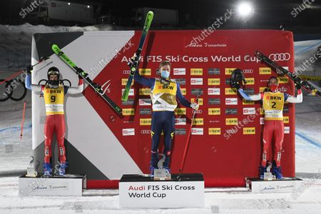 (L-R) The podium with second placed Alex Fiva of Switzerland, winner David Mobaerg of Sweden and Joos Berry of Switzerland pose after the finals of the men's FIS Freestyle Ski Cross World Cup in Arosa, Switzerland, 15 December, 2020.