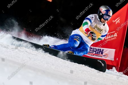 Roland Fischnaller of Italy competing in the Fis Snowboard World Cup 2021 Men's Parallel Giant Slalom on the Tondi Normale (Faloria) Course in the dolomite mountain range.