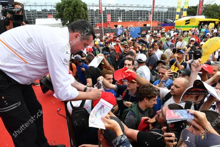 Eric Boullier (FRA) McLaren Racing Director signs autographs for the fans