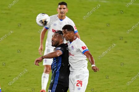 Stock Image of Montreal Impact forward Anthony Jackson-Hamel, left, and Olimpia defender Samuel Cordova (24) go up for the ball during the second half of a CONCACAF Champions League soccer match, in Orlando, Fla