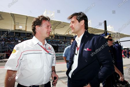Christian Horner (GBR) Red Bull Racing Sporting Director with Dany Bahar, Red Bull. Formula One World Championship, Rd 1, Bahrain Grand Prix, Race, Bahrain International Circuit, Bahrain, 12 March 2006. DIGITAL IMAGE