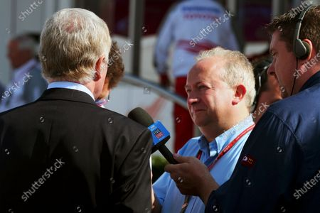 Stock Photo of Max Mosley (GBR) FIA President talks with Tony Dodgins (GBR) Journalist. Formula One World Championship, Rd 15, Italian Grand Prix, Race Day, Monza, Italy, 10 September 2006. DIGITAL IMAGE