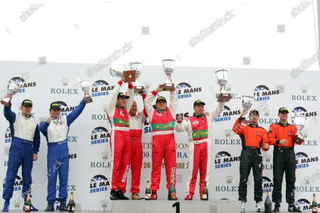 GT2 podium and results: 1st: Fabrizio de Simone (ITA) / Luca Drudi (ITA) / Gabrio Rosa (ITA) GPC Sport, centre. (later disqualified) 2nd: Warren Hughes (GBR) / Robert Bell (GBR) Team LNT, right. 3rd: Allan Simonsen (DEN) / Gunnar Kristensen (DEN) Autorlando Sport, left. Le Mans Series, Rd5, Jarama, Spain, 24 September 2006. DIGITAL IMAGE