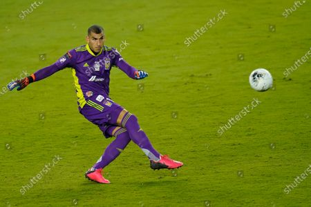 Tigres goalkeeper Nahuel Guzman (1) clears the ball from the goal during the first half of a CONCACAF Champions League soccer match against New York City FC, in Orlando, Fla