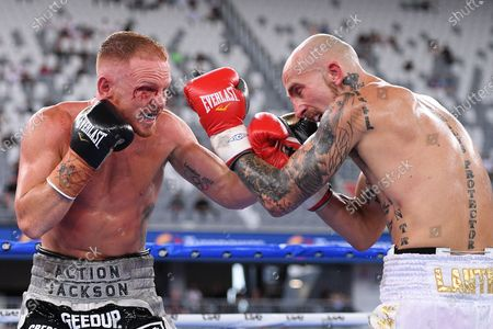 Luke Jackson (L) in action against Tyson Lantry (R) in their under card bout during the Sydney Super Fight ahead of the World Boxing Organization (WBO) Global light middleweight fight between Tim Tszyu and Bowyn Morgan at Bankwest Stadium in Sydney, Australia, 16 December 2020.