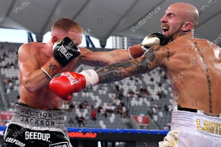 Stock Picture of Luke Jackson (L) in action against Tyson Lantry (R) in their under card bout during the Sydney Super Fight ahead of the World Boxing Organization (WBO) Global light middleweight fight between Tim Tszyu and Bowyn Morgan at Bankwest Stadium in Sydney, Australia, 16 December 2020.