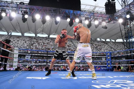 Stock Image of Luke Jackson (L) in action against Tyson Lantry (R) in their under card bout during the Sydney Super Fight ahead of the World Boxing Organization (WBO) Global light middleweight fight between Tim Tszyu and Bowyn Morgan at Bankwest Stadium in Sydney, Australia, 16 December 2020.