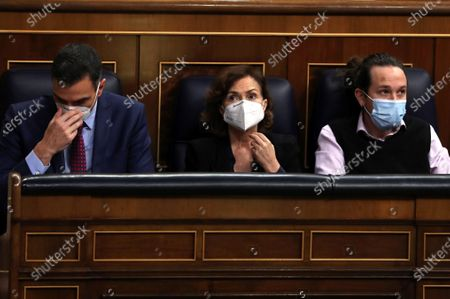 (L-R) Spanish Prime Minister Pedro Sanchez, Spanish first deputy Prime Minister Carmen Calvo, and Spanish second deputy Prime Minister Pablo Iglesias, during a Parliamentary session at the Lower House in Madrid, Spain, where Sanchez is to inform about the two last EU Councils and the current situation of the coronavirus pandemic in Spain, 16 December 2020.