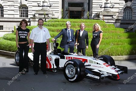 (L-R)  Silverstone Managing Director Richard Phillips (GBR) Damon Hill (GBR) BRDC President and Rick Parfitt (GBR) member of the band Status Quo pose to promote the 2006 British Grand Prix. 2006 British Grand Prix Promotion, London Marriott Hotel, England 23 May 2006. DIGITAL IMAGE