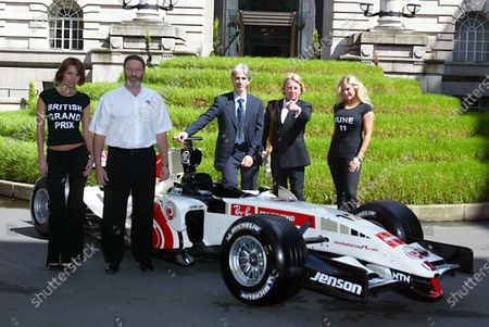 (L-R) Silverstone Managing Director Richard Phillips (GBR), Damon Hill (GBR) BRDC President and Rick Parfitt (GBR) member of the band Status Quo pose to promote the 2006 British Grand Prix. 2006 British Grand Prix Promotion, London Marriott Hotel, England 23 May 2006. DIGITAL IMAGE