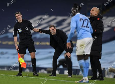 Stock Image of Slaven Bilic manager of West Bromwich Albion with the assistant referee