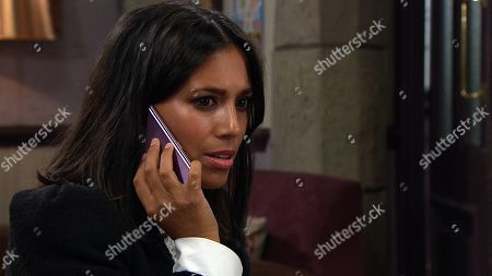 Emmerdale - Ep 8927 Tuesday 29th December 2020 Priya Sharma, as played by Fiona Wade, calls what she believes is Al's adoptive parents, unaware it's his mystery woman...
