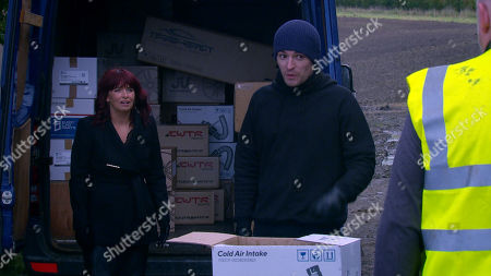 Emmerdale - Ep 8926 Monday 28th December 2020 Charity Dingle, as played by Emma Atkins, and Mack, as played by Lawrence Robb, try to rob a driver but it backfires when Charity is forced to knock him out by whacking him over the back of the head with a spanner. As Mack and Charity shift boxes from the van and sort through the loot, they continue to flirt. They're about to kiss when the driver wakes up and grabs a baseball bat...