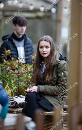 Stock Photo of Emmerdale - Ep 8937 Thursday 7th January 2021 - 2nd Ep Sarah Sugden's, as played by Katie Hill, shocked to see Danny's, as played by Louis Healey, helping Mason deal drugs but Danny talks his way around her and she asks Danny for one of his pills. Meanwhile, Chas isn't convinced by the denials of the stags and calls the police who conduct a drug search on them. Sarah then slips the pills she's in possession of into one of the stag's jackets. Will Sarah own up to this malicious act when the police find the drugs on him?