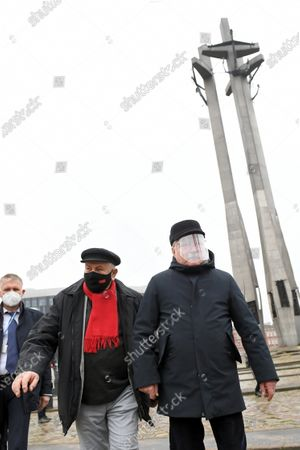 Former Polish President and leader of the Independent Polish Trade Union Solidarity, Nobel Peace Prize laureate Lech Walesa (R) wearing a protective face shield attends the ceremony of lighting candles and laying wreaths at the Monument to the Fallen Shipyard Workers in Gdansk, northern Poland, 16 December 2020. Ceremonies are held to observances marking the 50th anniversary of the tragic anti-communist protests of December 1970.