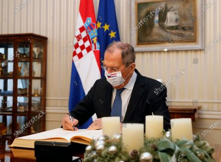 Russian Foreign Minister Sergei Lavrov signs a Croatian Golden Book before a meeting with Croatian Prime Minister Andrej Plenkovic in Zagreb, Croatia, 16 December 2020. Russian Foreign Minister pays a working visit to Croatia.