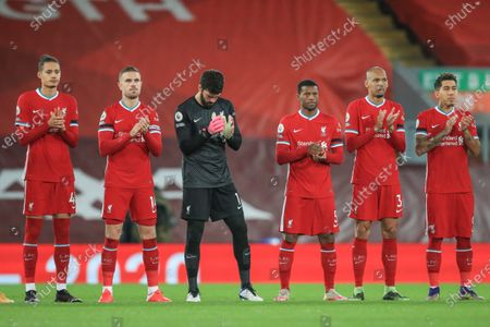Rhys Williams #46 of Liverpool Jordan Henderson #14 of Liverpool Alisson Becker #1 of Liverpool Georginio Wijnaldum #5 of Liverpool Fabinho #3 of Liverpool and Roberto Firmino #9 of Liverpool clap for a minute as they pay their respects to the late Gérard Houllier former Liverpool manager who sadly passed away on 14th December 2020