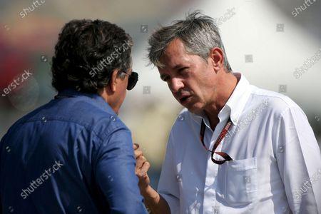 Giancarlo Minardi (ITA) talks with Daniel Morelli (ITA) the manager of Robert Kubica (POL) Formula One World Championship, Rd16, Chinese Grand Prix, Qualifying Day, Shanghai International Circuit, Shanghai, China, Saturday 6 October 2007.