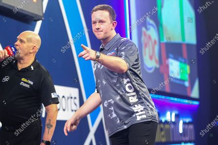 Callan Rydz hits a double and wins the match against James Bailey during the William Hill World Darts Championship at Alexandra Palace, London
