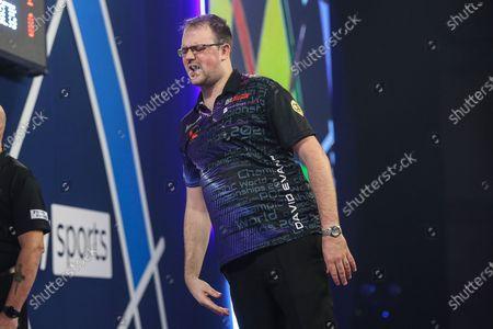 David Evans reaction after missing a dart at a double during the William Hill World Darts Championship at Alexandra Palace, London