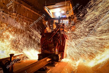 Sparks fly as a rail mobile flash butt welding machine works on the track of the Guangzhou Metro Line 18 in Guangzhou, south China's Guangdong Province, on Dec. 16, 2020. A total of 122.6 kilometers of railway tracks will need to be laid for the Guangzhou Metro Line 18, a subway line which is under construction with a maximum designed speed of 160 kilometers per hour.