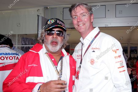 Dr Vijay Mallya (IND) CEO Kingfisher with Victor Muller (NED) Spyker. Formula One World Championship, Rd 9, British Grand Prix, Race, Silverstone, England, Sunday 8 July 2007.