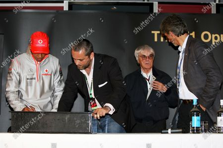 Lewis Hamilton (GBR) McLaren; Karl Fowler, founder of Kraken Sport & Media; Damon Hill (GBR) BRDC President and Bernie Ecclestone (GBR) F1 Supremo at the launch of the Opus F1 book. Formula One World Championship, Rd 9, British Grand Prix, Practice Day, Silverstone, England, Friday 6 July 2007.