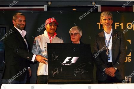(L to R): Karl Fowler, founder of Kraken Sport & Media; Lewis Hamilton (GBR) McLaren; Bernie Ecclestone (GBR) F1 Supremo and Damon Hill (GBR) BRDC President at the launch of the Opus F1 book. Formula One World Championship, Rd 9, British Grand Prix, Practice Day, Silverstone, England, Friday 6 July 2007.