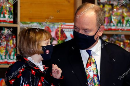 Prince Albert II of Monaco and Princess Gabriella, wearing protective face masks, attend the traditional Christmas tree ceremony at the Monaco Palace, as part of Christmas holiday season in Monaco, 16 December 2020.