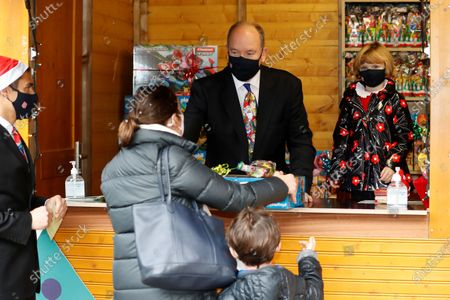 Stock Picture of Prince Albert II of Monaco and Princess Gabriella, wearing protective face masks, attend the traditional Christmas tree ceremony at the Monaco Palace, as part of Christmas holiday season in Monaco, 16 December 2020.