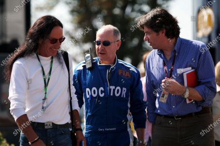 (L to R): Ken Hensley (GBR) former band member of Uriah Heep talks with Gary Hartstein (USA) FIA Doctor, and Leopold Wieland (GER) Managing Editor of Auto Bild Motorsport Magazine. Formula One World Championship, Rd 13, Italian Grand Prix, Race, Monza, Italy, Sunday 9 September 2007.